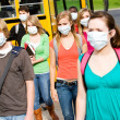 Royalty-Free Stock Photo: School Bus: Group of Students Wearing Face Masks