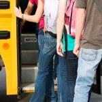 School Bus: Line of Students Leaving School — Foto Stock