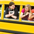 School Bus: Teens Leaning Out Bus Window — Stock Photo