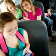 School Bus: Using a Smart Phone on the Bus — Zdjęcie stockowe