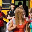 School Bus: Guy Flirts with Schoolgirl — Stock Photo #24216897