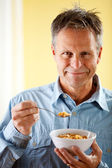 Couple: Bowl of Cereal for Breakfast — Stock Photo