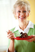 Couple: Woman with a Plate of Chocolate Cake — Stock Photo