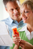 Couple: Man and Woman Dealing with Medication — Stock Photo