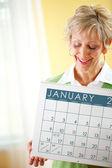 Couple: Holding a January Calendar — Stock Photo