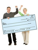 Couple: Holding Up a Blank Check — Stock Photo