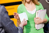 School Bus: Teacher Handing Out Face Masks — Stock Photo