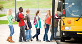 School Bus: Line of Students Boarding Bus — Stok fotoğraf