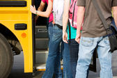 School Bus: Line of Students Leaving School — Stock Photo