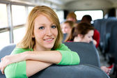 School Bus: Female Student Leaning On Seat — Stock Photo
