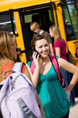 School Bus: Girl Calls Friend Before Boarding Bus — Stock Photo