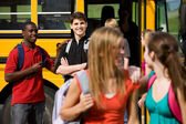 School Bus: Guy Flirts with Schoolgirl — Stock Photo