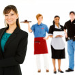 Occupations: Confident Businesswoman Leads Group — Photo