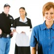Stock Photo: Occupations: Happy Server with Others Behind