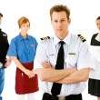 Occupations: Airline Pilot Leads Serious Group — Stockfoto