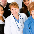 Occupations: Doctor in Center of Group of Occupations — Stock Photo