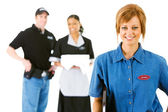 Occupations: Happy Server with Others Behind — Stock Photo