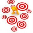 3d Guy: Standing Amid Targets Waiting to Be Hit - Stock Photo
