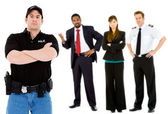 Occupations: Serious Policeman with Others Behind — Stock Photo