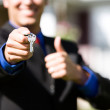 Home: Agent With Keys Gives Thumbs Up — Stock Photo