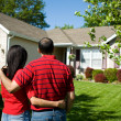 Home: Owners Admiring their Home — Stock Photo #24358149