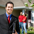 Stock Photo: Home: Real Estate Agent Ready to Sell Home