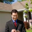 Stock Photo: Home: Real Estate Agent Phoning Buyers