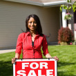 Home: Woman Ready to Sell House - Stock Photo