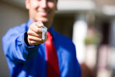 Home: Agent Handing Over Home Keys — Stock Photo