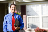 Home: Cheerful Real Estate Agent — Stock Photo