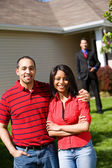 Home: Couple Ready to Work with Real Estate Agent — Stock Photo