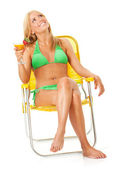 Swimsuit: Woman Relaxing in Chair — Stock Photo