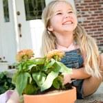 Gardener: Cute Girl Potting Plants — Stock Photo #24434551