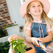 Gardener: Little Girl Having Fun with Flowers — Stock Photo