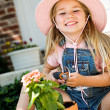 Gardener: Cheerful Girl Potting Plants — Stock Photo #24434571