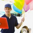 Delivery: Man Taking Balloons to House — Stock Photo
