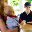 Delivery: Deliveryman Checking Name on List — Stock Photo