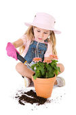 Gardener: Putting Dirt into Pot — Stock Photo