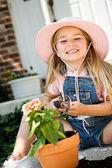 Gardener: Cheerful Girl Potting Plants — Stock Photo
