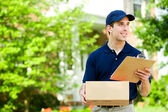 Delivery: Holding Parcel for Delivery — Stok fotoğraf