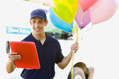 Delivery: Man Taking Balloons to House — Stok fotoğraf