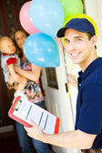 Delivery: Deliveryman with Balloon Bouquet — Stock Photo