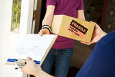 Delivery: Delivering a Fragile Package — Stock Photo