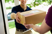 Delivery: Giving Package to Home Owner — Stock Photo