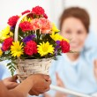 Stock Photo: Hospital: WomReaches for Flower Gift