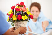 Hospital: Woman Reaches for Flower Gift — Stok fotoğraf