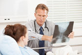 Hospital: Doctor Having Serious Discussion with Patient — Stock Photo
