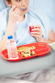 Hospital: Woman Eating Gelatin in Hospital — Stock Photo