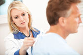 Hospital: Physician Listening to Lungs — Stock Photo