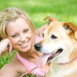 Park: Cute Woman with Dog - Stock Photo